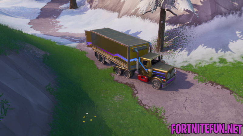 Search Between A Basement Film Camera, A Snowy Stone Head And A Flashy Gold Big Rig Fortnite Location
